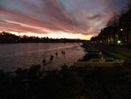 Sunset over Kaisaniemenlahti by MissLumikki