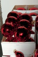 red xmas bulbs in white box by steppelandstock