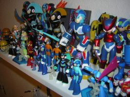 Megaman figures and TF by SmilehKitteh