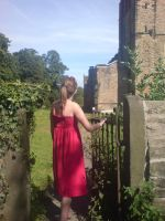 Girl in Red Dress pushing gate by EmKins-Resources