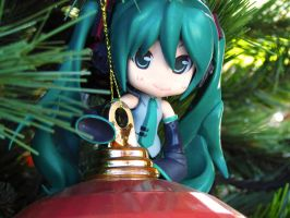 Playing in the christmas tree by Bokehlie
