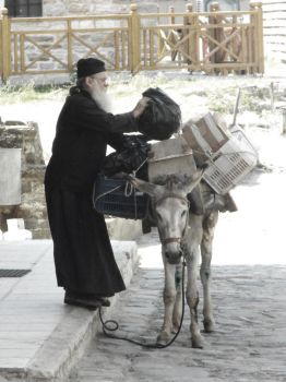 Monk with donkey by TalusPhotography