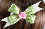 Green lace bow with pink rhinestone center rose by BowtisticDreams