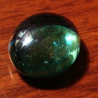 Tumbled Glass Emerald Gemstone by FantasyStock