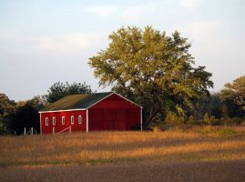 Red barn by SolStock