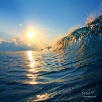 Sunset with ocean wave by Vitaly-Sokol