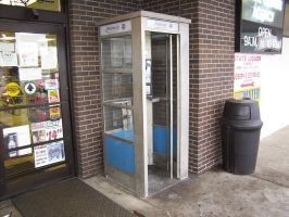 Last Phone Booth in Town by studio-toledo