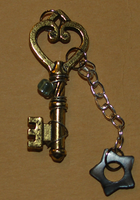 : key and star charm by ZombieDogInk
