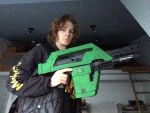 Me holding the M41a Pulse Rifle Nerf gun 4 by EJLightning007arts