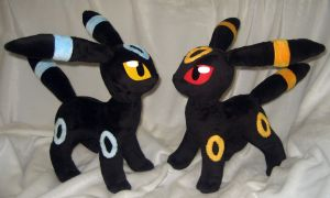 Regular and shiny Umbreon by Rens-twin