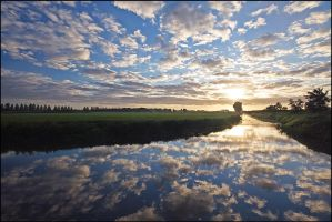 Reflection of the clouds by Betuwefotograaf