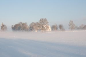White house on a snowy field by RavensLane