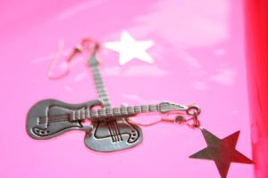 guitar on pink by thom-cat