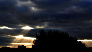 Sun rays and stormy skies by RavensSoulDesigns