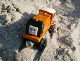 Rusty in the Sand by RustyFanatic05