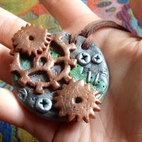 Polymer clay steampunk green pendant by SillyElectron