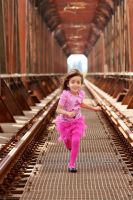 Daughter running down the tracks :) by 7whitefire7