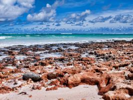 Red ochre beach by peterpateman