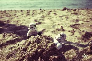 Stormtrooper buried in the beach by Z-UO