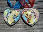 For Sale: Plusle and Minun Charms by BlackManaBurning