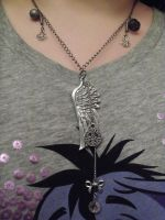 Wing of Peace Necklace by LadyMidnight81