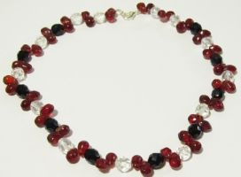 pomegranate seed necklace by AnaInTheStars