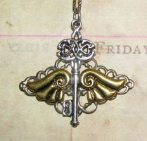 Skeleton key and wings mounted on antiqued brass by GraceCM