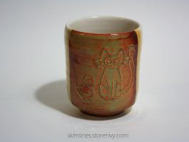 Surprise cat, duck, and bird one sided tea cup by skimlines