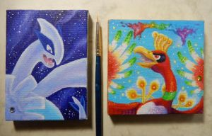 Ho-oh and Lugia paintings back to back