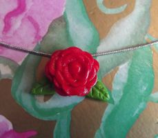 Red flower pendant by MeticulousBlue
