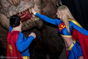 Superman and Supergirl Vs. Rancor 1 by Insane-Pencil