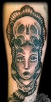 Woman with skull by state-of-art-tattoo
