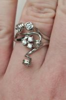 Silver ring with set stones (zirkonia) by marpletje