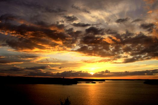 Cloudy sunset by MarvinOs