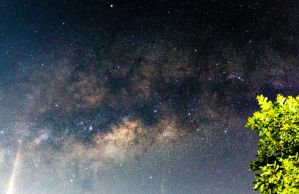 Moon flare over the Milky Way by jdrephotography