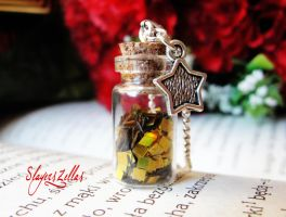 Tiny bottle necklace with golden glitter quadrats by Benia1991
