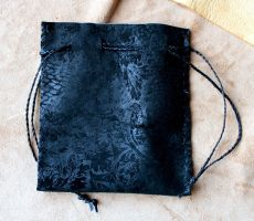 Embossed black leather pouch by lupagreenwolf