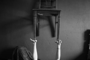 Hanging chair girl holding by vallendesterstock