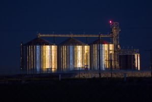 Silos by night by Delusionist