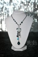 Rose Charm Necklace in blue on gunmetal by shoudoumagic