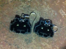 space invader cross stitched earrings by UnyieldingMadness