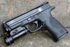 Smith and Wesson Military and Police 40 Caliber by PLutonius