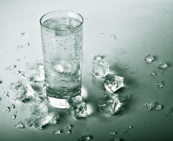 a glass of melted ice by Mirlenges