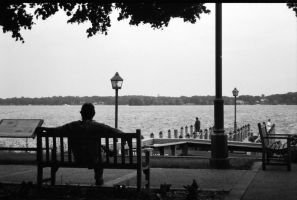 Dude on bench and stuff by Claevius