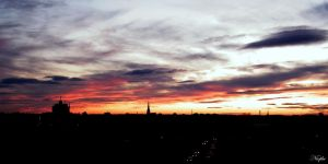 Sunset over Leipzig panorama by Niophee