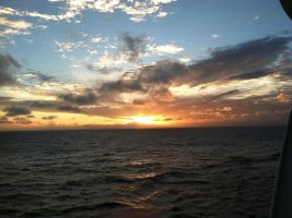 Another sea voyage sunset by Wintaria