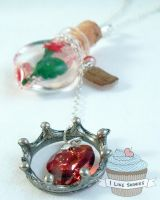 Heart of the beast- Enchanted Rose necklace by ilikeshiniesfakery
