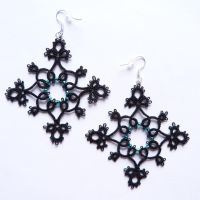 Black tatted earrings by nikkichou