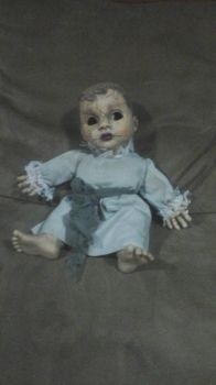 Creepy Doll by Taureansmithpartee