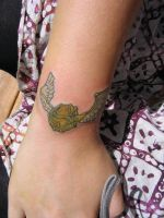 My first tattoo- golden snitch by MalletGirl